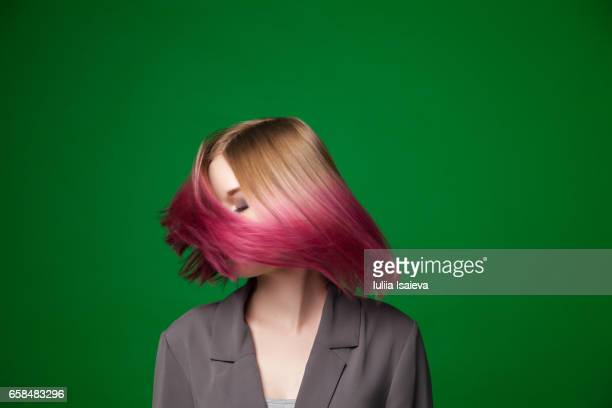Female with dyed hair posing