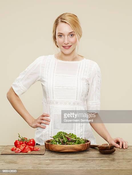 female with ingredients for a fresh salad - weißes kleid stock-fotos und bilder