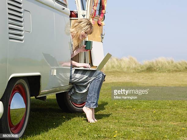 Female with laptop in Camper Van