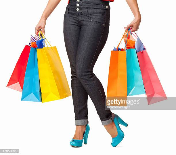 female with shopping bags - isolated - skinny jeans stock pictures, royalty-free photos & images