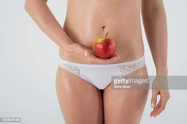 female womb and an apple. debica, poland - female reproductive system stock photos and pictures