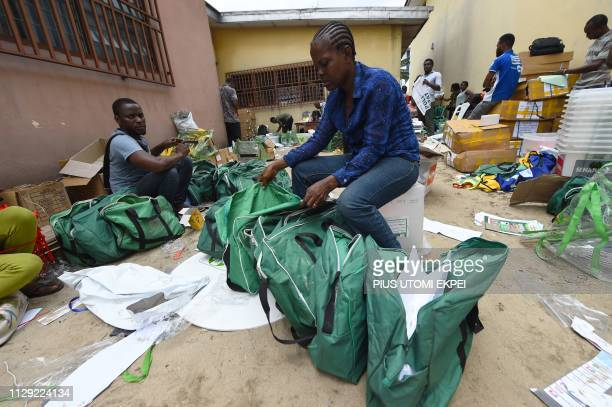 A female worker arranges electoral materials before their distribution to wards at the Independent National Electoral Commission central office in...