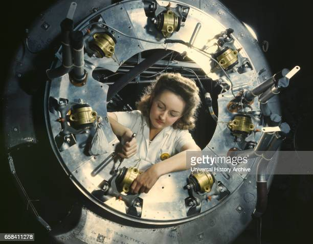 Female Worker Assembling B25 Bomber Engine North American Aviation Plant Inglewood California USA Alfred T Palmer for Office of War Information...