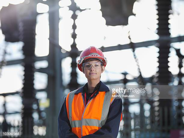 female worker at power station - power station stock pictures, royalty-free photos & images