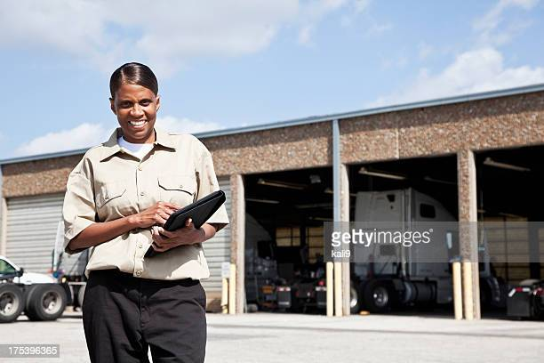 female worker at trucking facility - auto repair shop exterior stock pictures, royalty-free photos & images