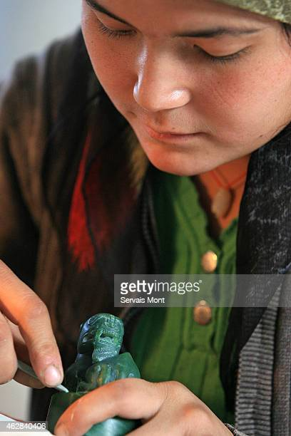 A female worker carves a Jade jewel on October 13 2006 in Hetian Xinjiang province China The Uyghur people are a Turkic ethnic group living mainly in...