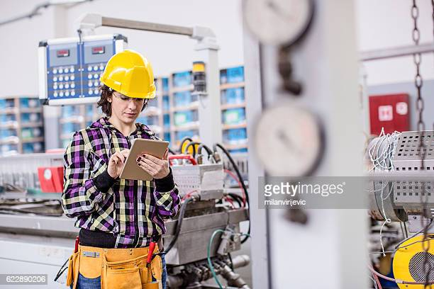 Female worker in a factory