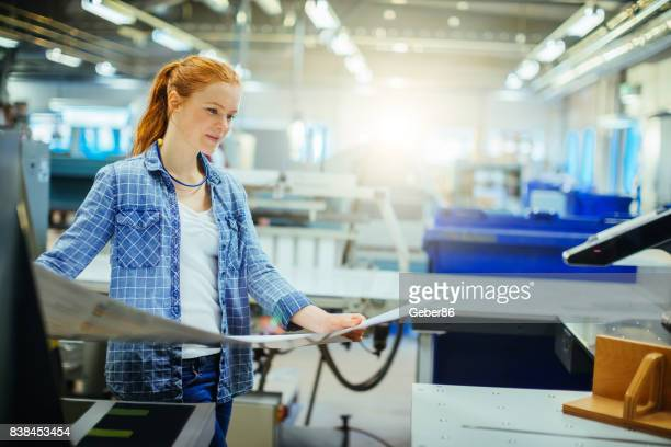 Female worker in a printing factory