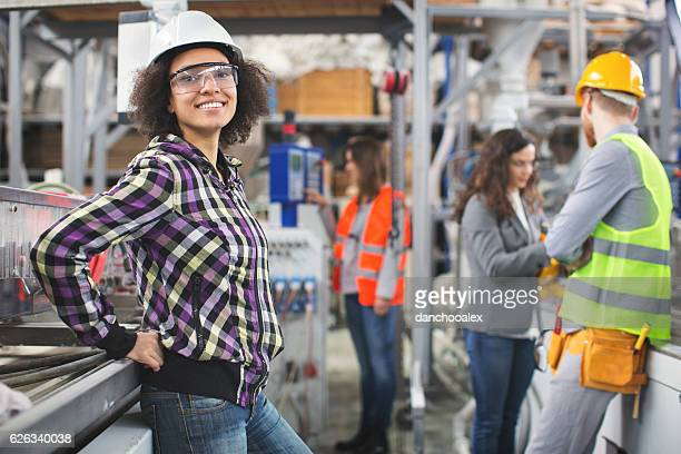 Female worker in the factory posing for the camera