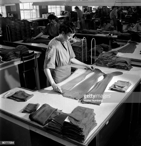 A female worker inspects finished nylon stockins at The Aristoc hosiery factory at Langley Mill near Nottingham Th e factory thrived before and after...