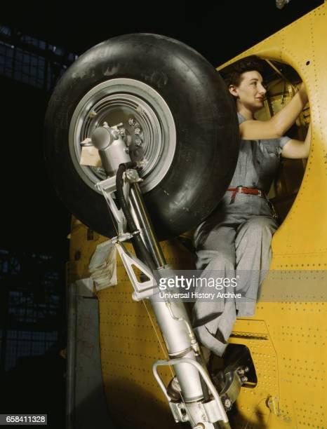 Female Worker Making Final Adjustments in Wheel Well of Inner Wing Before Installation of Landing Gear Vultee 'Vengeance' Dive Bomber Nashville...