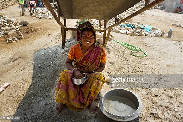 A female worker named Shuma is taking her lunch with only rich and potato smash in a Stone Crashing Plant in Sylhet Bangladesh A huge percentage of...