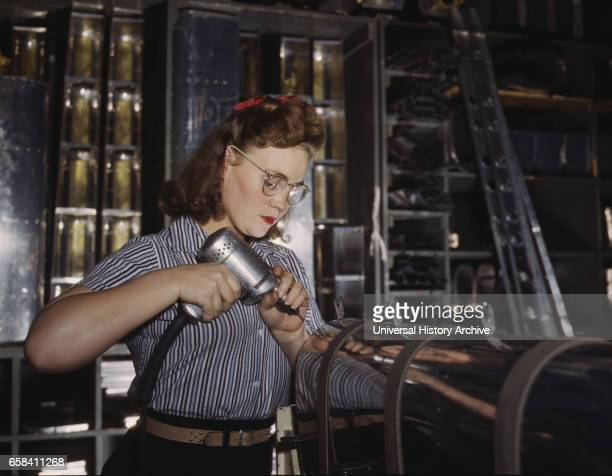 Female Worker Operating Hand Drill North American Aviation Inc Inglewood California USA Alfred T Palmer for Office of War Information October 1942