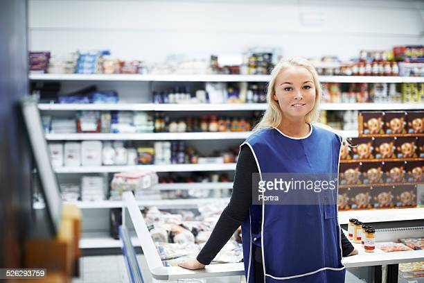 Female worker standing in convenience store