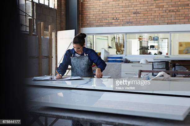 female worker taking notes of measurements - the_writer's_block stock pictures, royalty-free photos & images