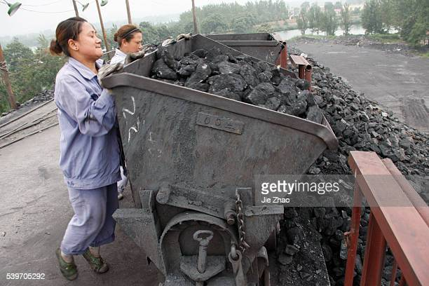 A female worker works at a coal dump site of a coal mine in Huaibei Anhui province August 24 2010 VCP