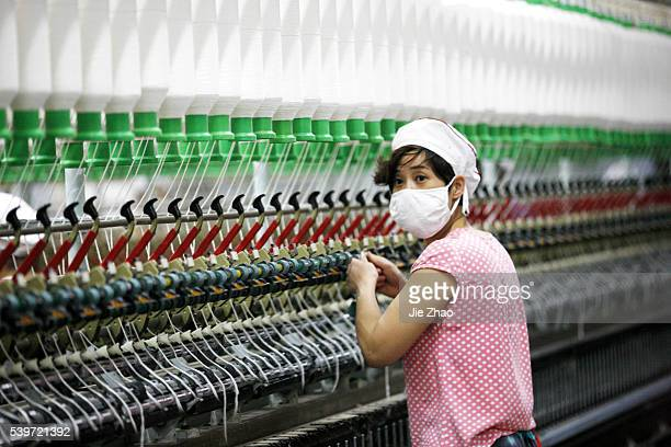 A female worker works in a textile factory in Huaibei Anhui province Chin on 19th October 2015 Gross domestic product rose 69 percent in the three...