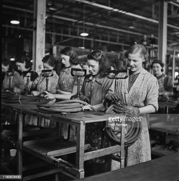 Female workers at a stirrup pump factory in the UK during World War II, June 1941. From a Ministry of Information special.