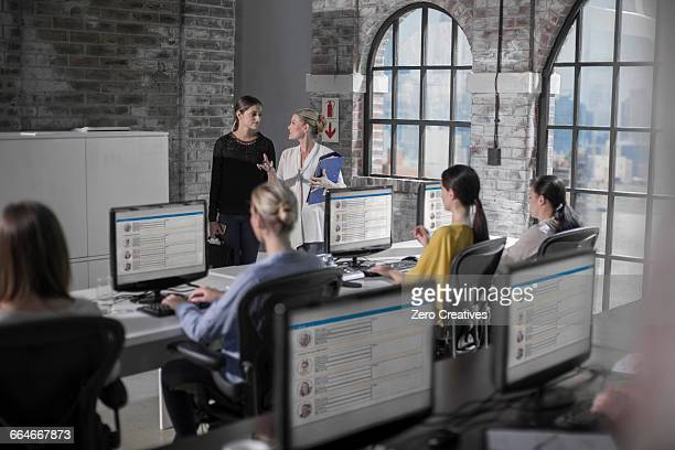 Female workers at training presentation in call centre
