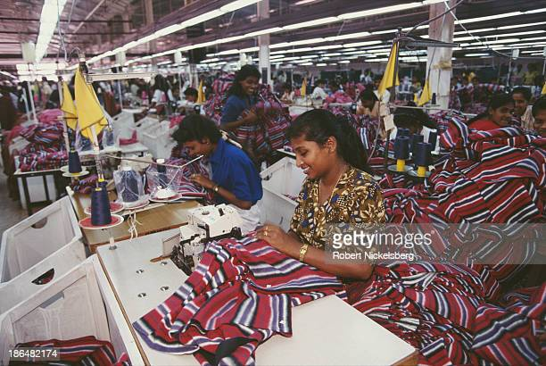 Female workers busy on the production line within the Liz Claiborne textile factory in Colombo Sri Lanka circa 1998