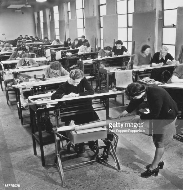 Female workers in the Tracing Office at an Avro factory in Greater Manchester 16th March 1942 The workers' role is to trace draughtsmen's pencil...
