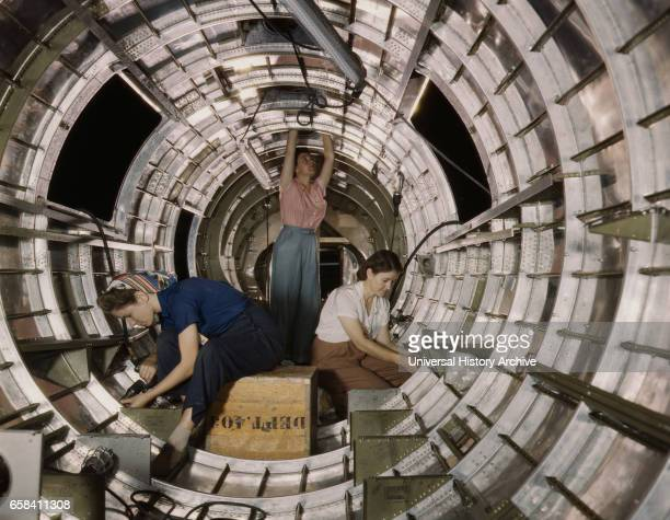 Female Workers Installing Fixtures to Tail Fuselage of B17F Bomber Douglas Aircraft Company Long Beach California USA Alfred T Palmer for Office of...