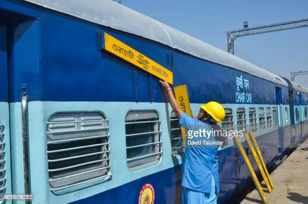Female workers of the of Northeast Frontier Railway engaged in the maintenance of railway coaches