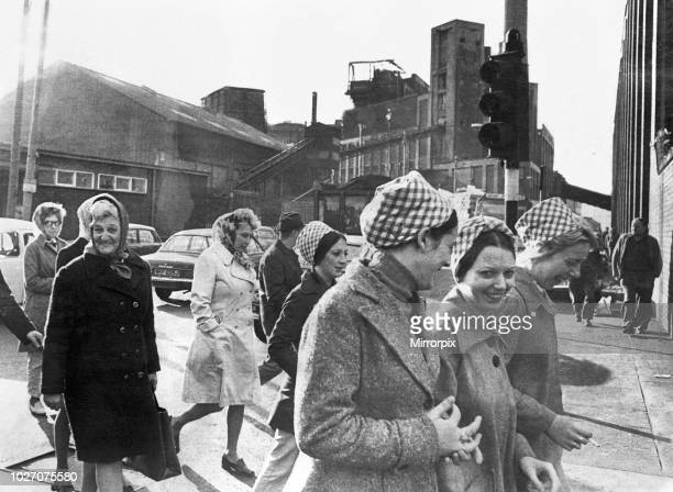 Female workers of the Tate and Lyle sugar refinery in Liverpool make their way to the staff canteen to consider action to offset the threat to the...