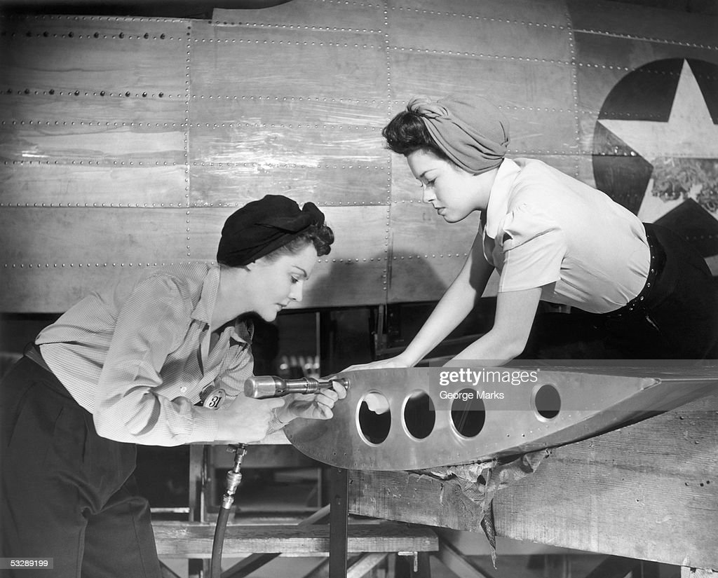 Female workers working on plane : Stock Photo