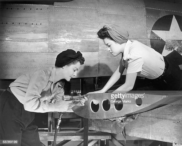 female workers working on plane - home front stock pictures, royalty-free photos & images