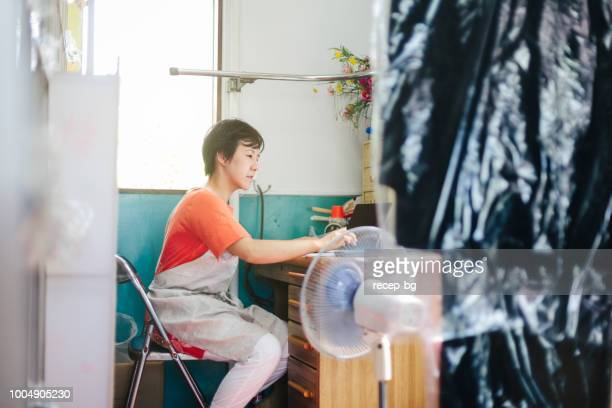 Female working doing accountancy in dry cleaning shop