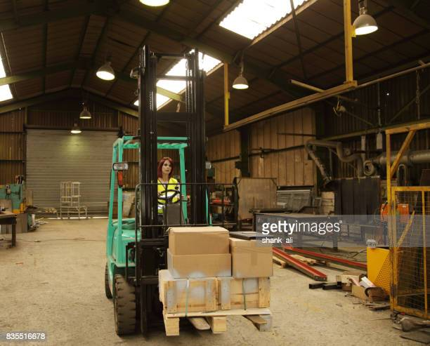 female working inside an engineering workshop - industrial door stock pictures, royalty-free photos & images