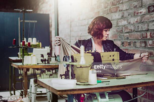 Female working on sewing machine in bridal shop
