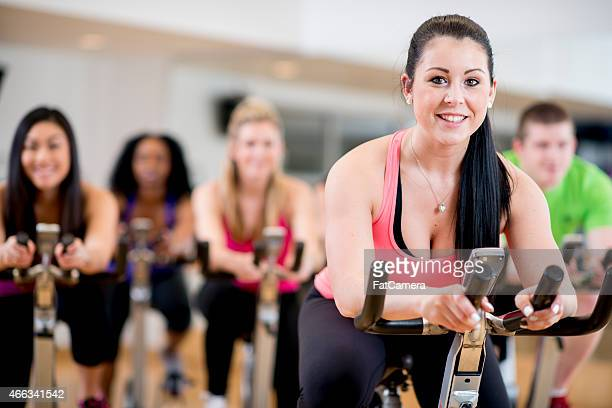 Female Working Out in Spinning Class