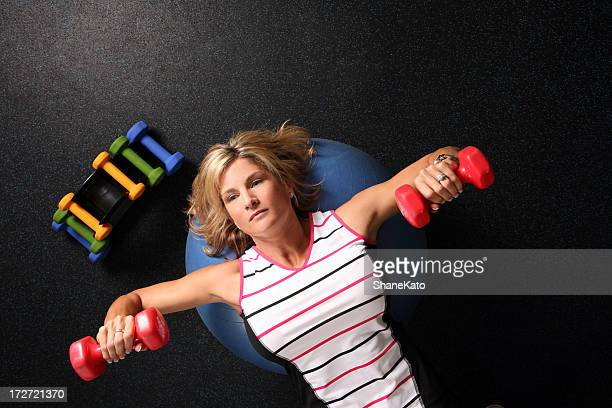 female workout weightlifting with bumbells and barbells for fitness - voluptuous breasts stock pictures, royalty-free photos & images