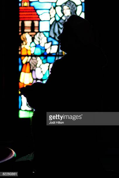 A female worshipper prays at the alter after Sunday mass at Our Lady of Czestochowa a Polish Catholic church Sunday February 27 2005 in South Boston...