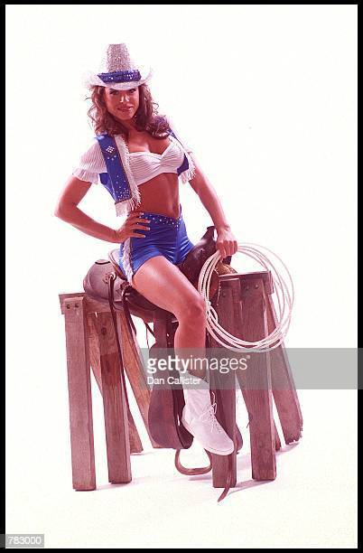 Female wrestler Bronco Billie poses on a saddle August 2 2000 at the Great Western Forum in Los Angeles CA