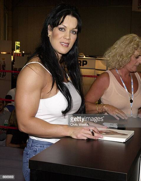 WWF female wrestler Chyna signs autographs at the Video Software Dealer's Association annual convention at the Venetian July 8 2000 in Las Vegas NV