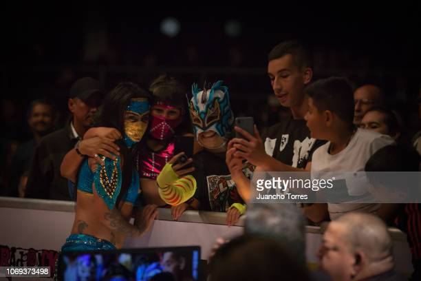 Female wrestler Lady Shani takes a selfie with fans during an AAA World Wide Wrestling match on November 16 2018 in Bogota Colombia