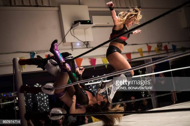 TOPSHOT Female wrestlers are pictured during a show on March 11 in Nanterre near Paris In Nanterre the French Association of Professional Wrestling...