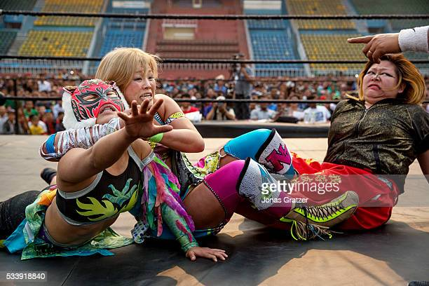 Female wrestlers wrestle in the ring The first international wrestling competition was held at Dashrath Stadium in Kathmandu / Nepal 16 April 2016...