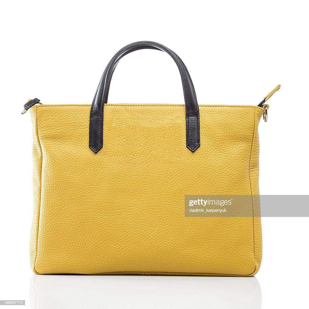 female yellow leather handbag : Stock Photo