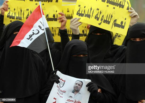 A female Yemeni protester waves a modernized version of her national flag and a picture of a local activist Tarek Sorour who the opposition allege...