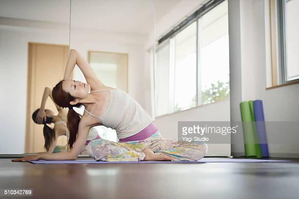 Female yoga instructor enjoying  yoga