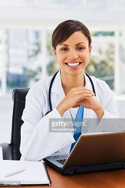 Female young doctor with laptop