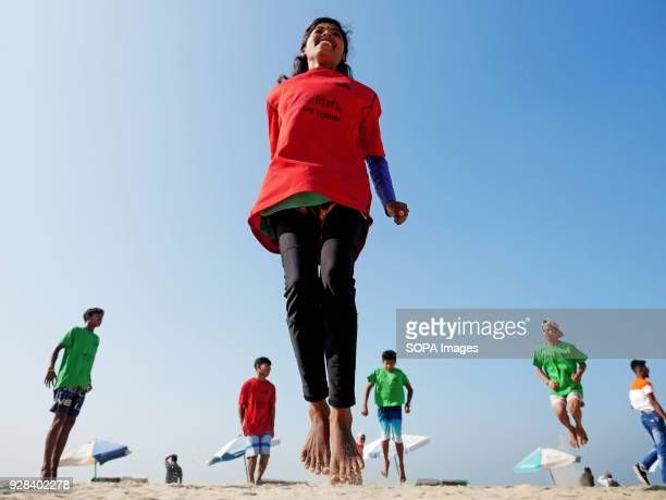 A female young surfer seen warming up at the beach Young people in the world´s longest sandy beach in Cox´s Bazar Bangladesh decided to throw away...
