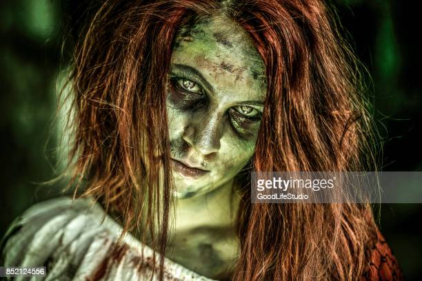 female zombie - zombie makeup stock photos and pictures