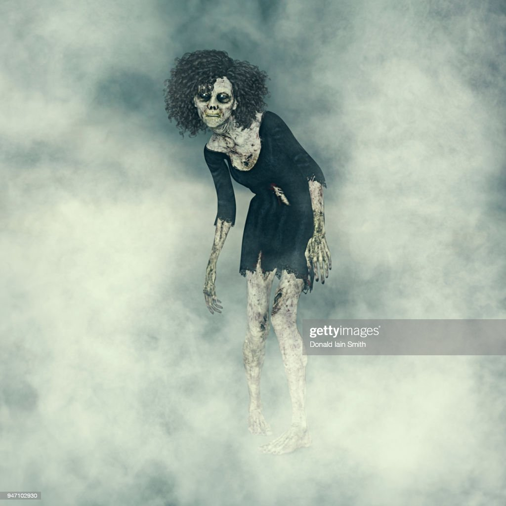 Female Zombie With Glowing Eyes Emerging From Fog Stock Photo