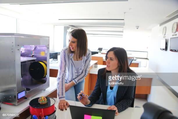 Females Designer Working With 3D Printer