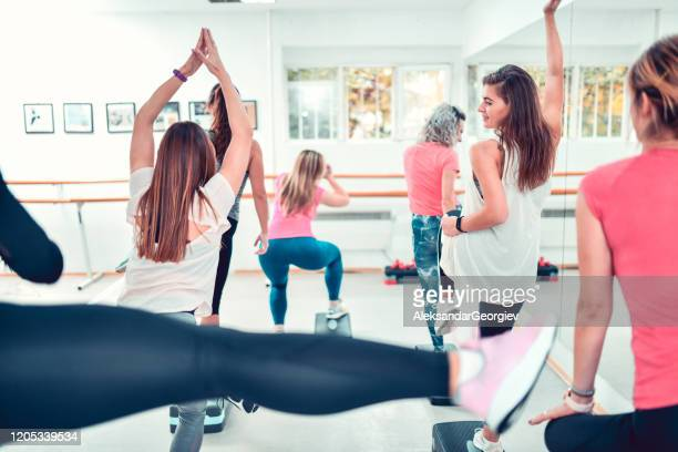 females doing squats and other stepping exercises in gym - beautiful female bottoms stock pictures, royalty-free photos & images